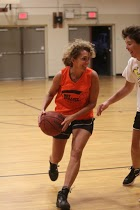 Susan Pillsbury playing basketball over 50 in Maine