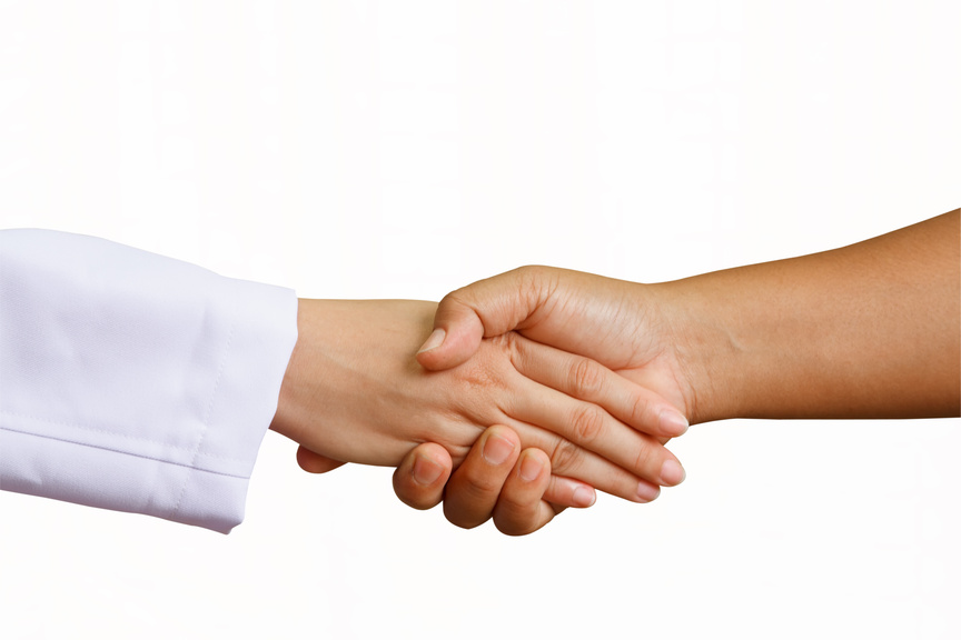 doctor shakes hands with patient