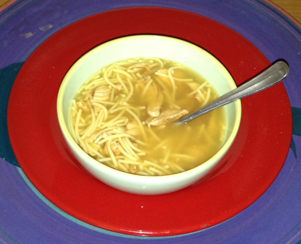 Chicken soup with lemon, garlic and ginger as a sore throat remedy