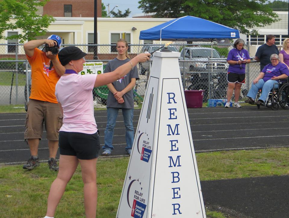Christie Cantara lighting the Flame of Hope at the Relay for Life in Wells