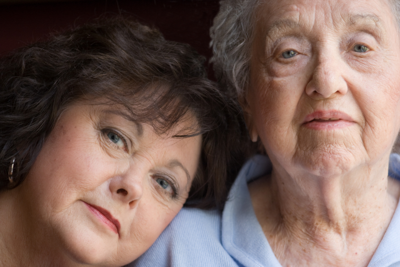 Elderly woman and daughter