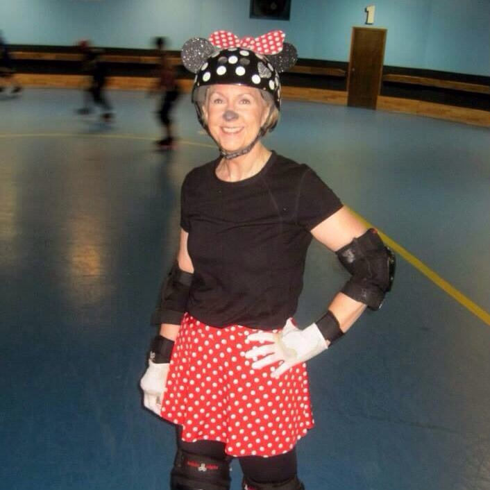 Linda in costume on skates