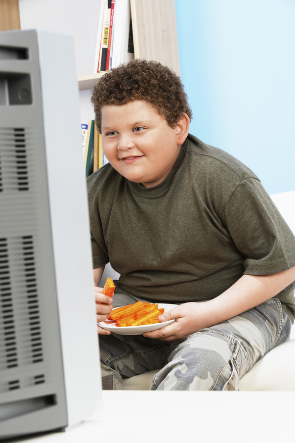 Overweight Child Eating Carrot Sticks