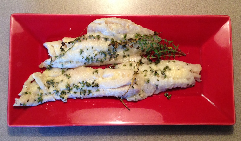 Baked fish on red serving platter