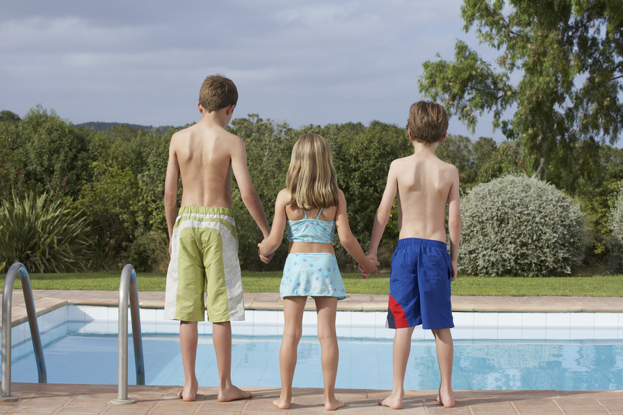 Children at the edge of swimming pool