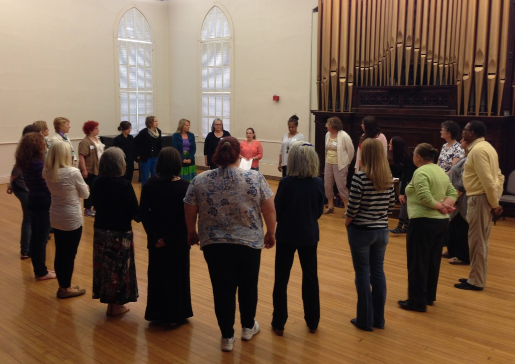 Group of adults standing in a circle/art/music/movement therapy