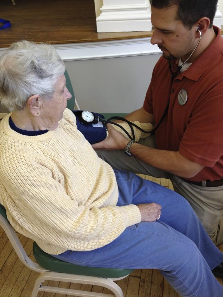 Fran Paris getting her blood pressure checked