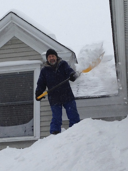 My husband shoveling