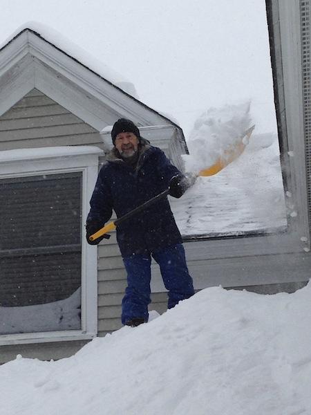 My husband shoveling