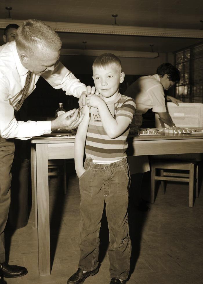 Boy getting measles vaccine