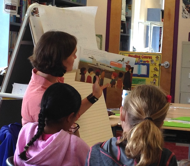 Kelly reading book to students