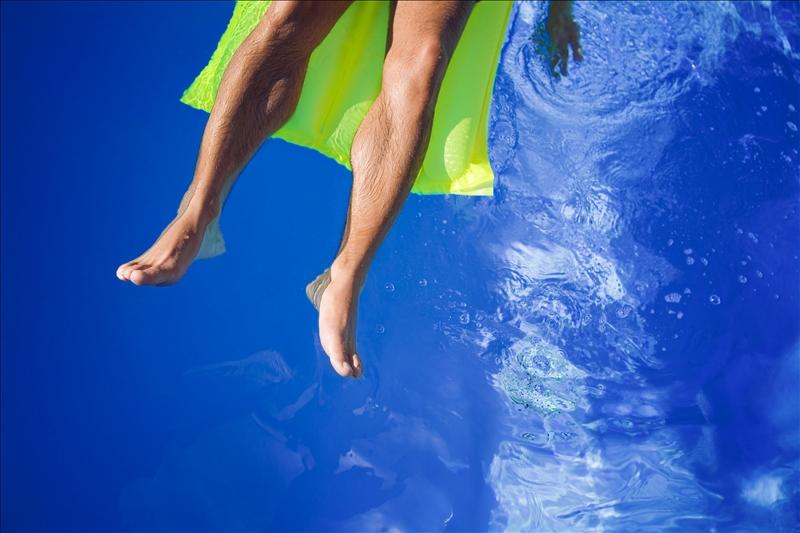 Men's legs in sun