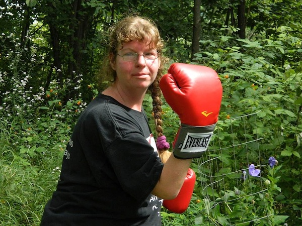 Vanessa wearing red boxing gloves