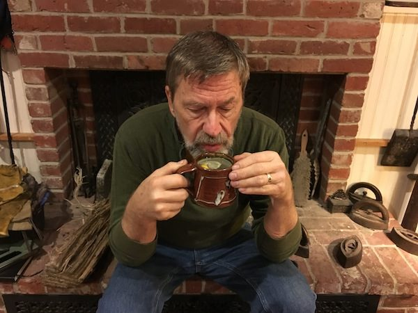 Diane Atwood's husband sipping tea because of a cold