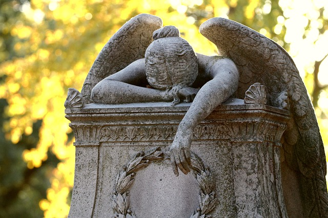 Grieving angel cemetery monument