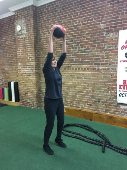 Slamming down a medicine ball