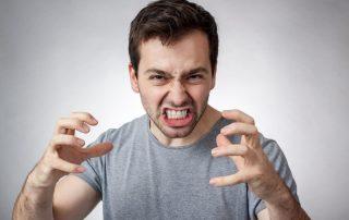Man clenching teeth