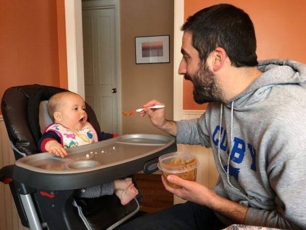 Keegan feeding Coraline