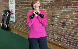 Diane exercising with kettlebells