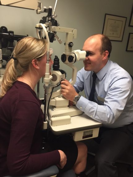 Dr. Kearins doing an eye exam