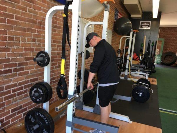 Andy Wight lowering push ups bar