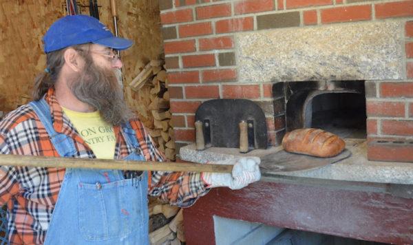 Dusty Dowse baking bread at Lammastide Bakers