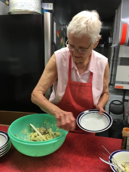Jan Bell serving potato salad