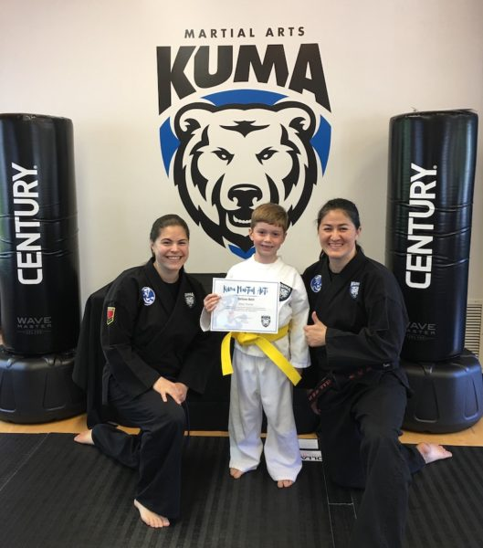 Mason getting his yellow karate belt