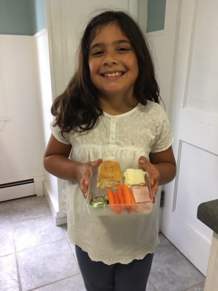 Ramona holding her Lovables school lunch