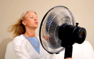 Woman with fan/menopause