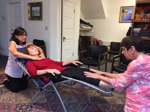 Diane getting a Reiki treatment