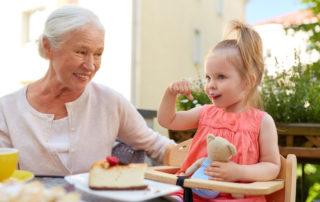 Grandmother and little girl eating (longevity)