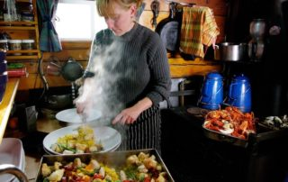 Annie Mahle cooking in the schooner galley