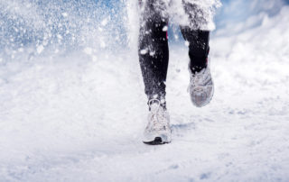 Feet running in snow