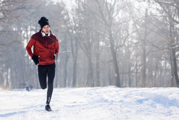 Person running in winter/Adobe