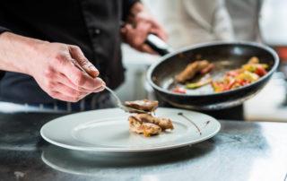 Chef plating food