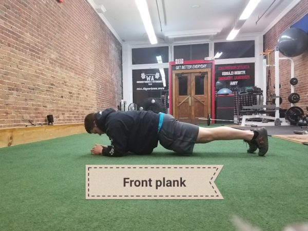 Andy demonstrates plank