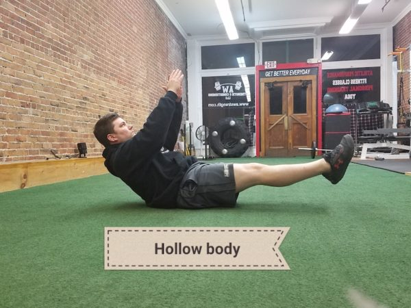 Andy demonstrating hollow body exercise