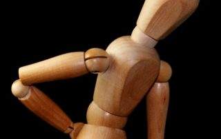 Wooden model holding onto back