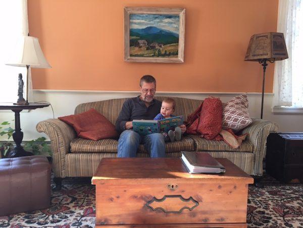 Diane's husband and granddaughter reading together