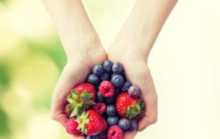Woman holding berries/MIND diet