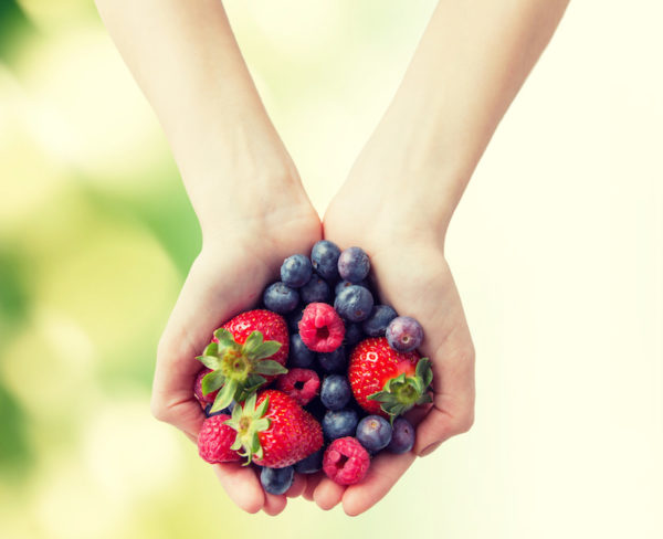 Woman holding berries/MIND diet
