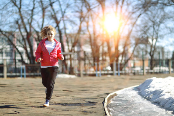 Woman running in early spring