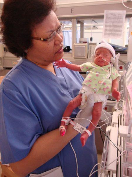 Nurse with Jen's newborn daughter