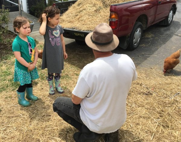 Michael talking to Nora and Sofia about the goats
