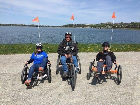 Two Hanger clinicians and a patient on adaptive cycles