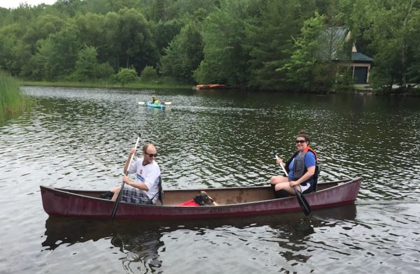 Two people and a doggie in a canoe