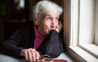 ElderlyElderly woman looking out window