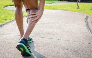 Runner holding leg