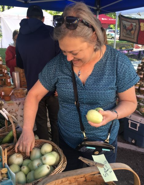 Karen choosing lemon cucumbers